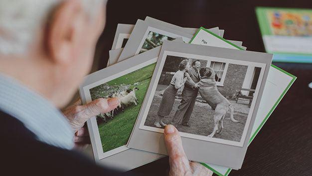 man looking at old photographs