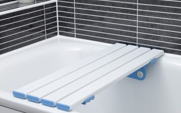 Slatted bath board attached to a bath