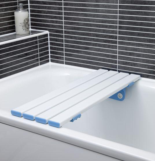 Slatted bath board attached to a bath