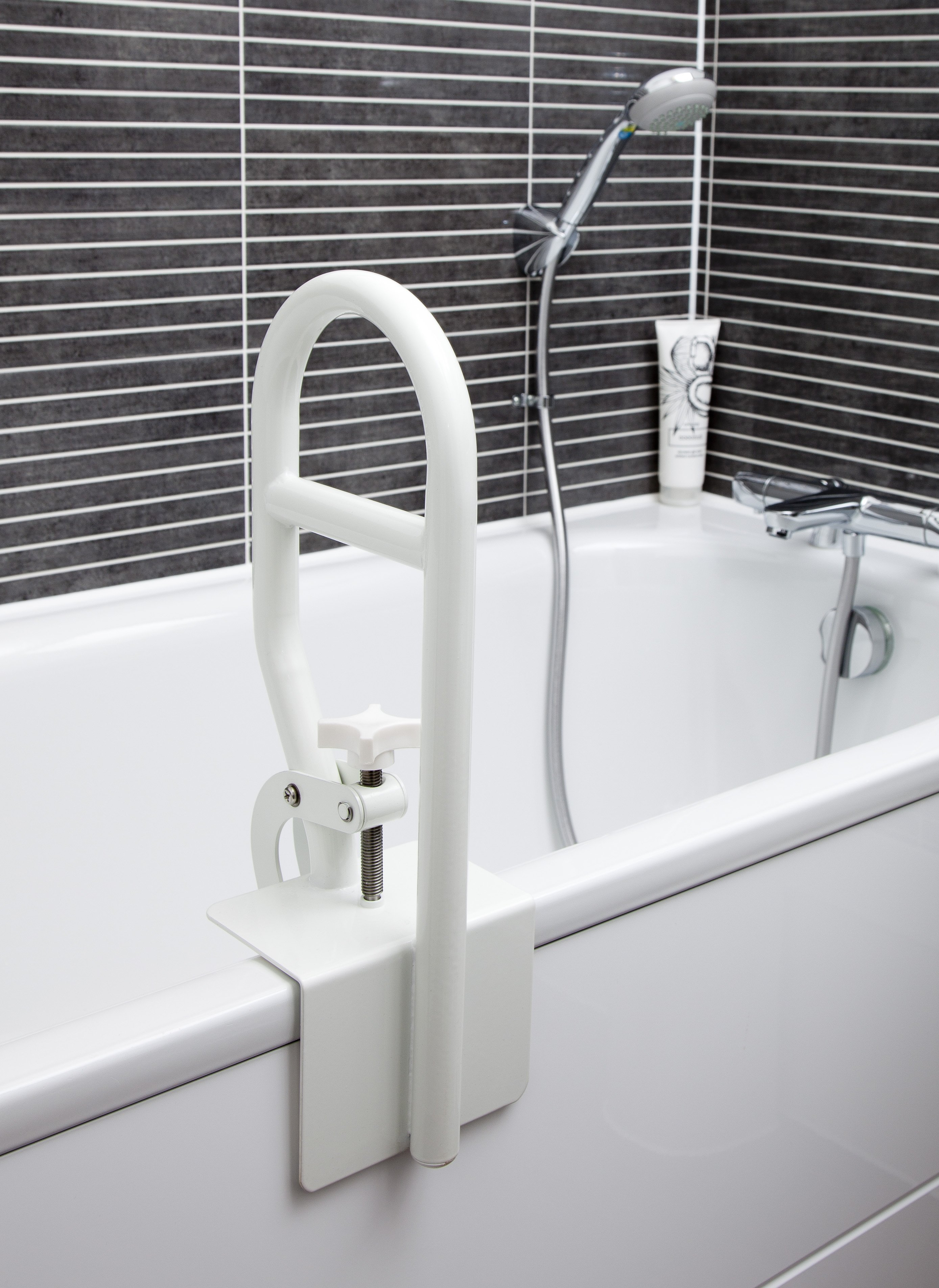 Grab rail attached to the side of a bath