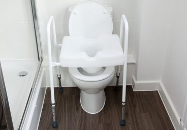 Raised toilet seat with grab-hold rails