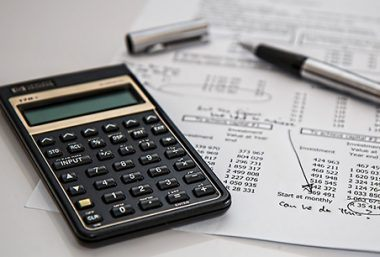 calculator and printed budget figures